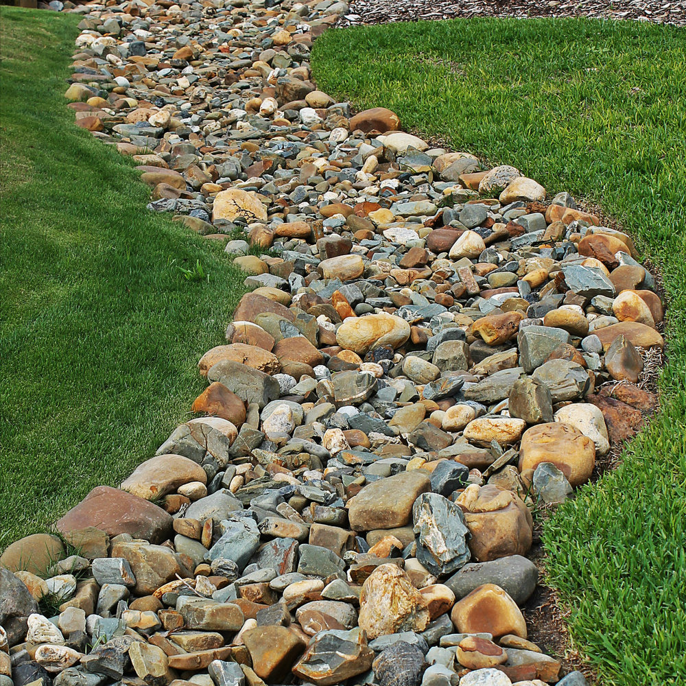 Petty 39 s irrigation landscape ltd drainage french for Installing river rock landscaping