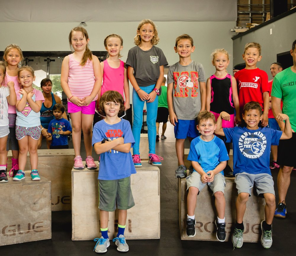 KCI KIDS - KCI Kids uses the CrossFit methodology and incorporates age-appropriate skills, drills, and exercises to enhance kids' confidence, agility, strength, balance and coordination.  We have classes for Ages 6-12. Please contact nick@kcicrossfit.com to try it out or for class schedule!