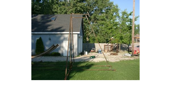 Soon, construction begins in the yard.  All but a few of the pieces are hand made in the garage.
