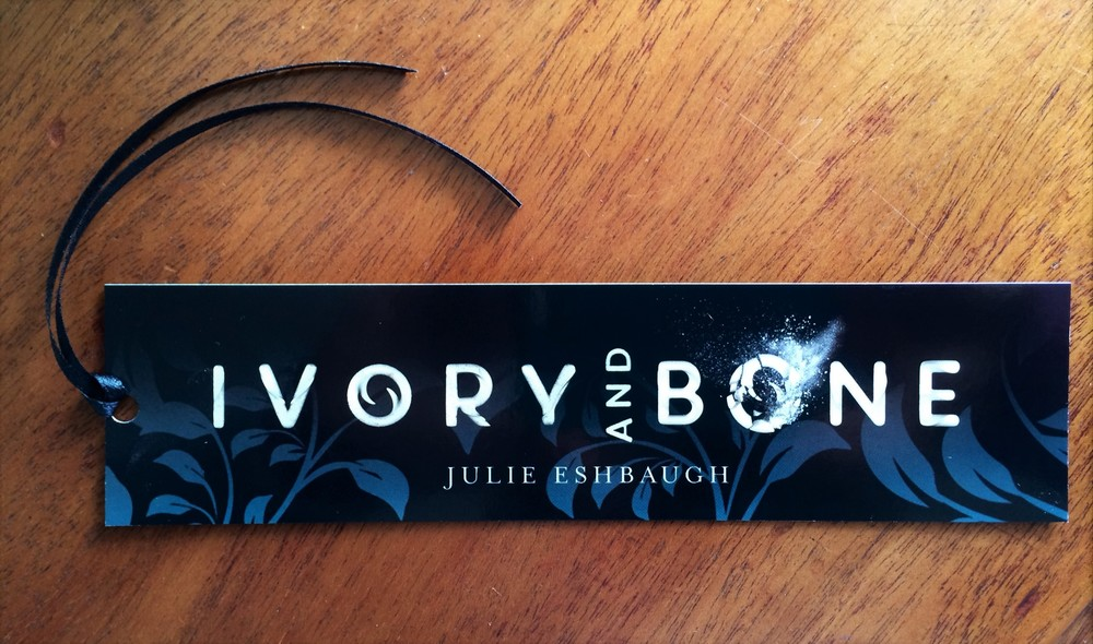 This is a photo of the pre-order bookmark, showing the ribbon! (The color is more accurate in the picture on top.)