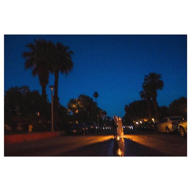 Blurry, grainy... moody street photo of @alservi and @dyavorsky 🌴♥️ #bride#groom#newlyweds#weddingphotojournalism#palmsprings#palmspringswedding#twilight#moodygram#loved#wedding#documentaryweddingphotographer#fujifeed#fujifilm#후지필름#신랑신부