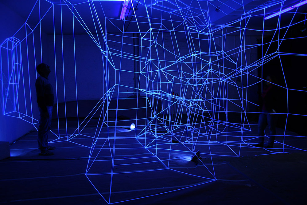 Degrees of Freedom (Placeholder for new work), 2013 String, Nails, Black Light  Variable dimensions