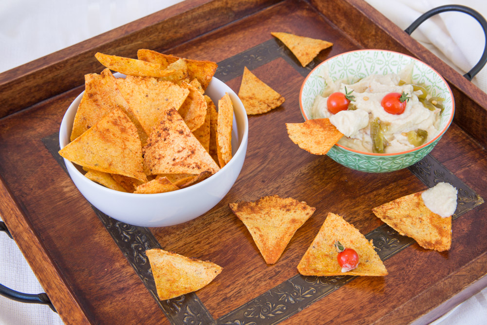 Chili Spiked Lime Tortilla Chips with Queso.