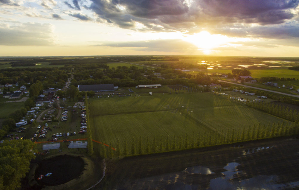 An aerial view of Mile 60 Park at sunset after the demolition derby in 2016