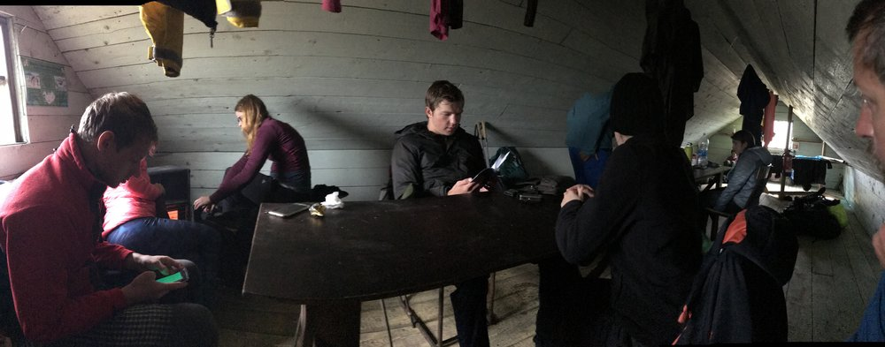 Inside the barn attempting to dry out and warm up with other trekkers