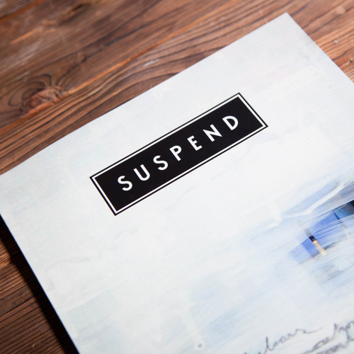 SUSPEND identity as it appeared on the cover of ISSUE 04 by Justin Ward. Art by Cole Sternberg.