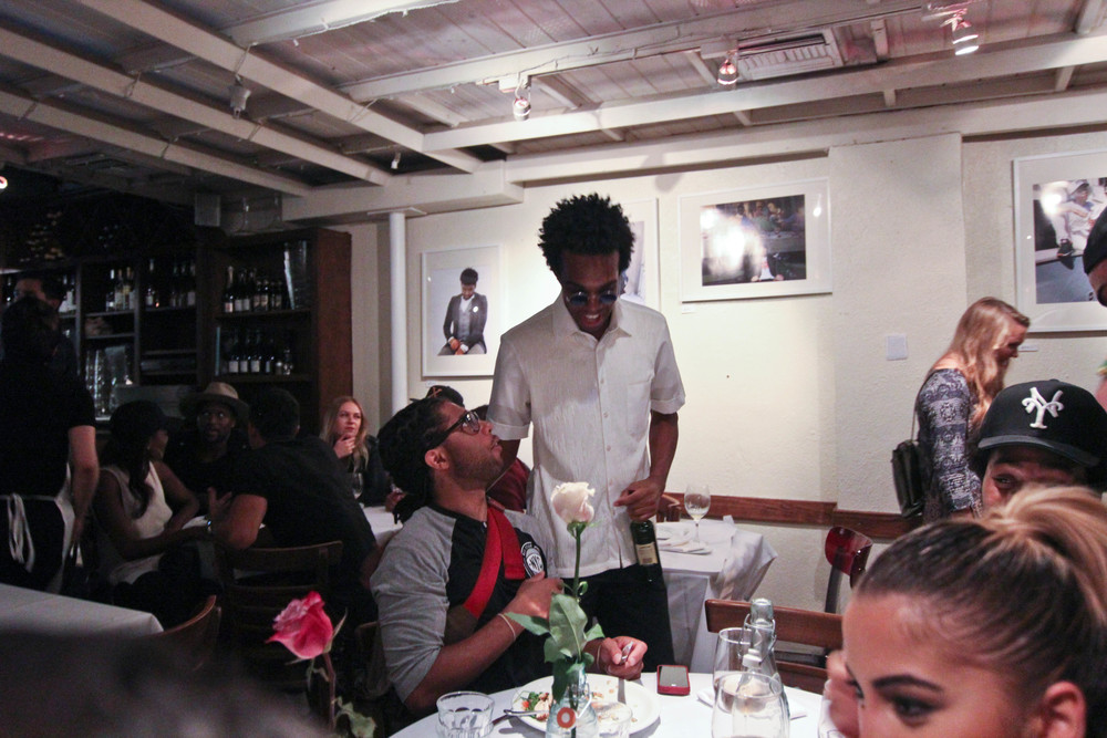 Featured artist Jonathan Tate chats with Nsilo Welsh at Mauro's Cafe at Fred Segal. / Photo: © Christy J Kim