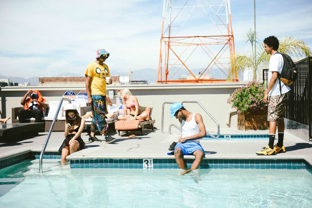 "(L-R) Doja Cat, Left Brain and Go Dreamer on the set of ""WAVE"" in Downtown Los Angeles at a rooftop pool. / Photo: © Diane Abapo, SUSPEND Magazine"