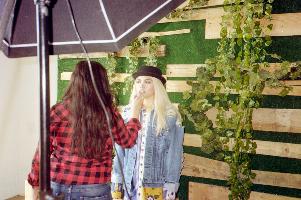 Hayley Kiyoko on the set of her cover shoot for ISSUE 05 of SUSPEND with makeup artist Marla Vazquez. / Photo: © Diane Abapo