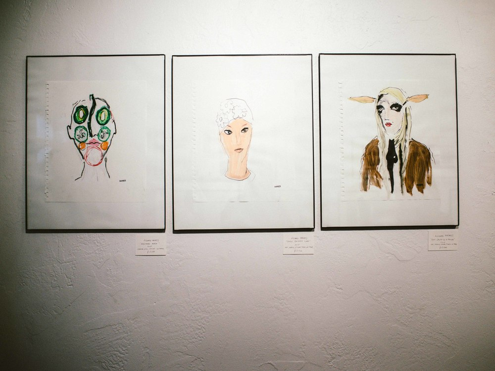 "Richard Haines pieces on display at Huberty-Breyne Gallery at Aqua Art Miami. From L-R: ""Vegetable Mask"" (2015), Charcoal & oil crayon on paper, $2200; ""Single Bathing Cap"" (2015), Ink, acrylic and color pencil, $2200; ""Patti Spliff As A Faun"" (2015), Ink, acrylic and color pencil on paper, $2200. / Photo: © Diane Abapo for SUSPEND Magazine."