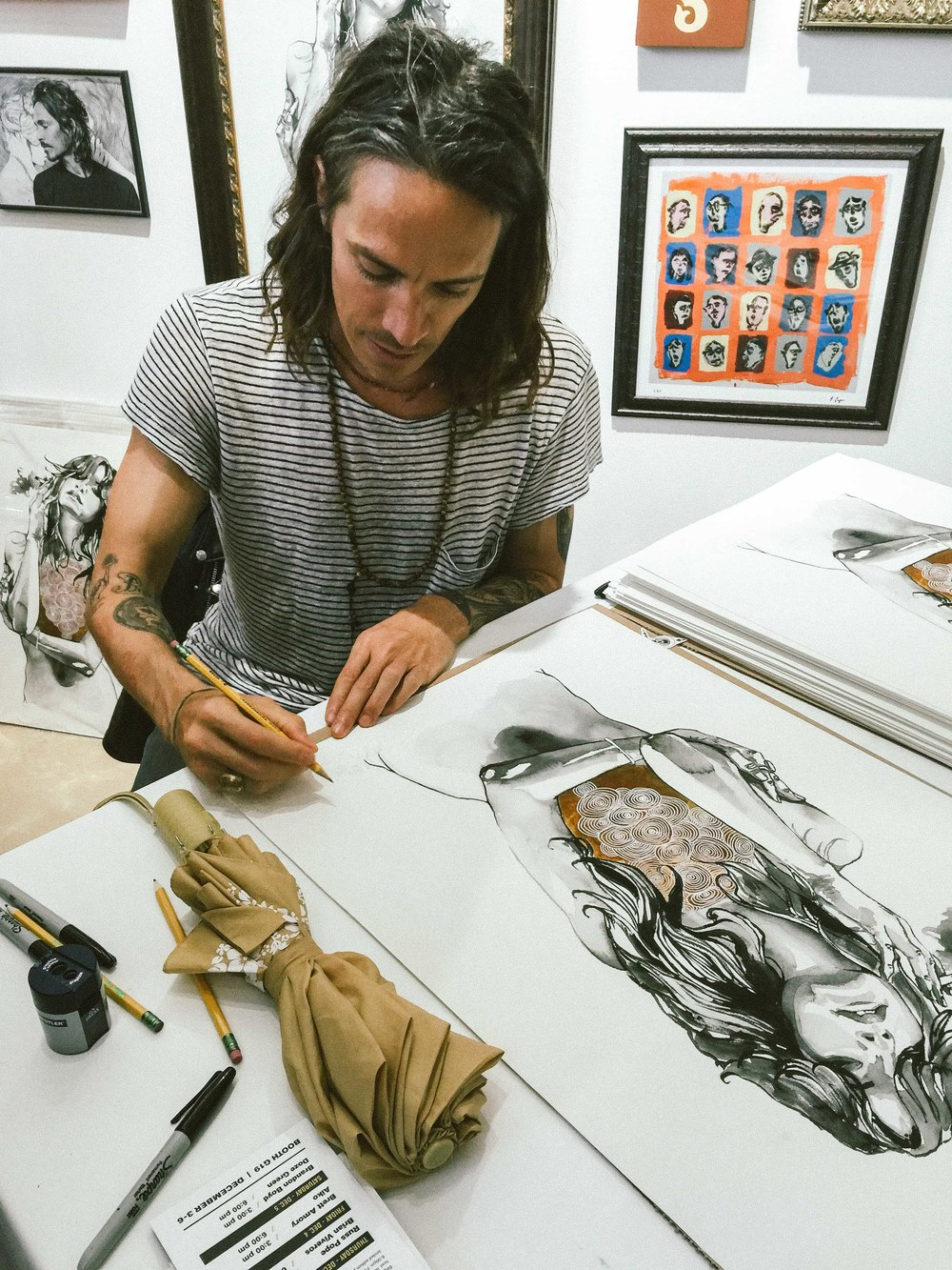"Brandon Boyd at the Juxtapoze Magazine signing his ""Heart of Gold"" prints (edition of 100) at Scope Art Fair (Dec 5) / Photo: © Diane Abapo for SUSPEND Magazine."