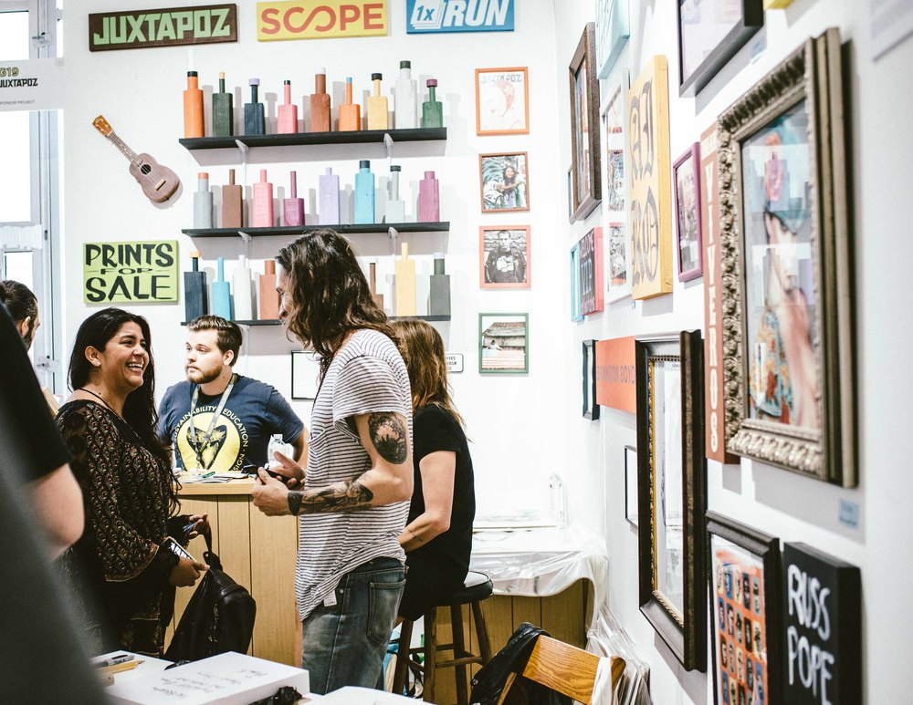 "Brandon Boyd at the Juxtapoze Magazine booth for the limited release of his ""Heart of Gold"" prints (edition of 100) at Scope Art Fair (Dec 5) / Photo: © Diane Abapo for SUSPEND Magazine."