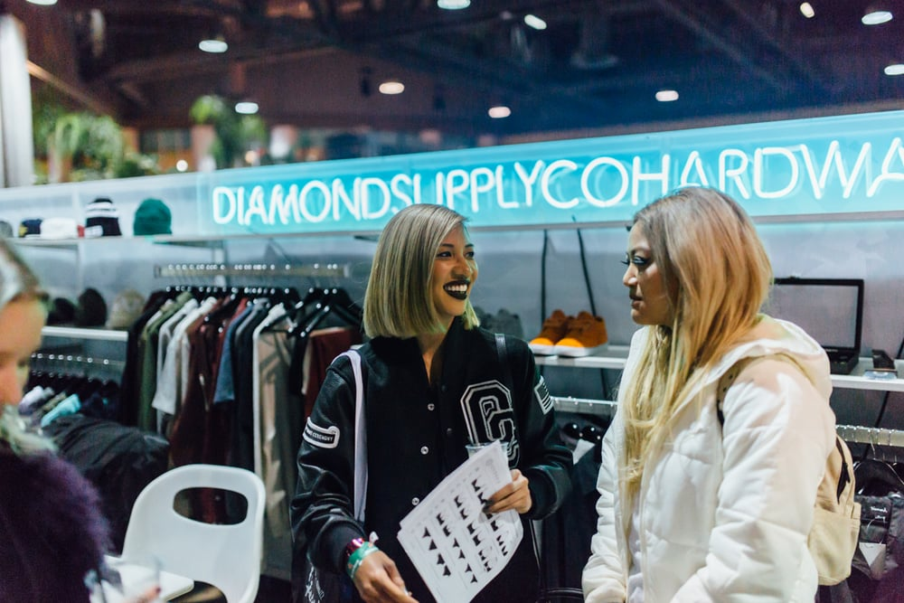 Fashion Editor Leslie Corpuz with Bana Bongolan of Diamond Supply Co. at Agenda Long Beach. / Photo: © Kayla Reefer for SUSPEND Magazine.