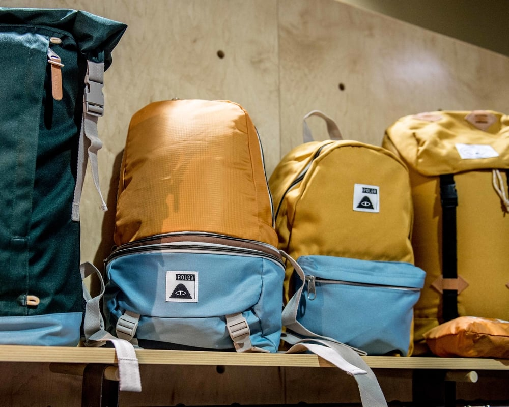 Poler's Tourist Pack (left, Mustard) and Rambler Pack (right, Mustard) on display at Agenda Long Beach. / Photo: © Diane Abapo for SUSPEND Magazine.