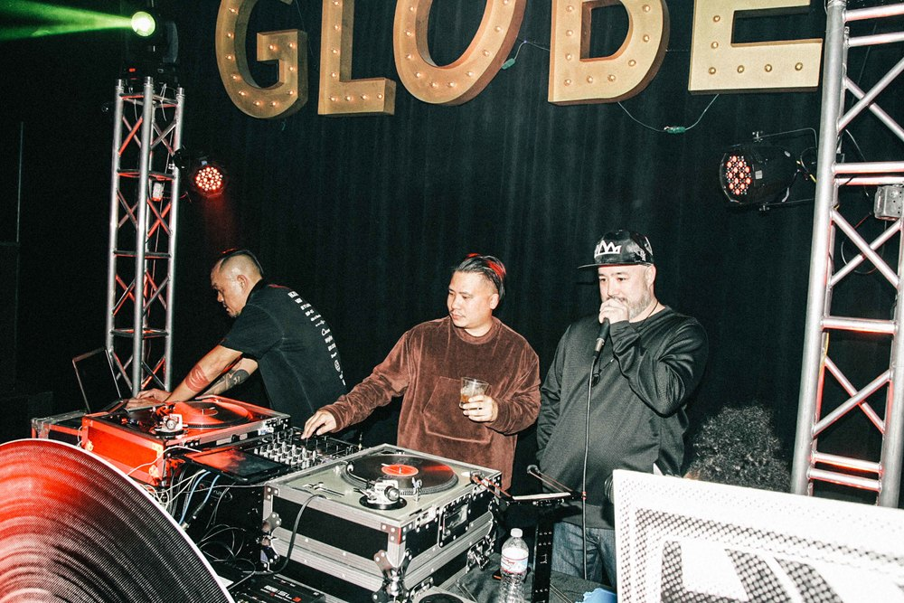 Bam Barcena (center) assisting Mr. Hek at the ISSUE 06 Release Party x 10YR HLZBLZ Anniversary (Feb 11) at Globe Theater. / Photo: © Jonathan Tate for SUSPEND Magazine.