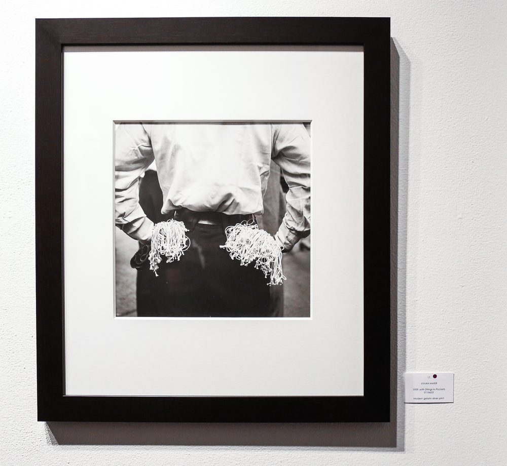 1959, with Strings in Pockets (Modern gelatin silver print) by Vivian Maier.