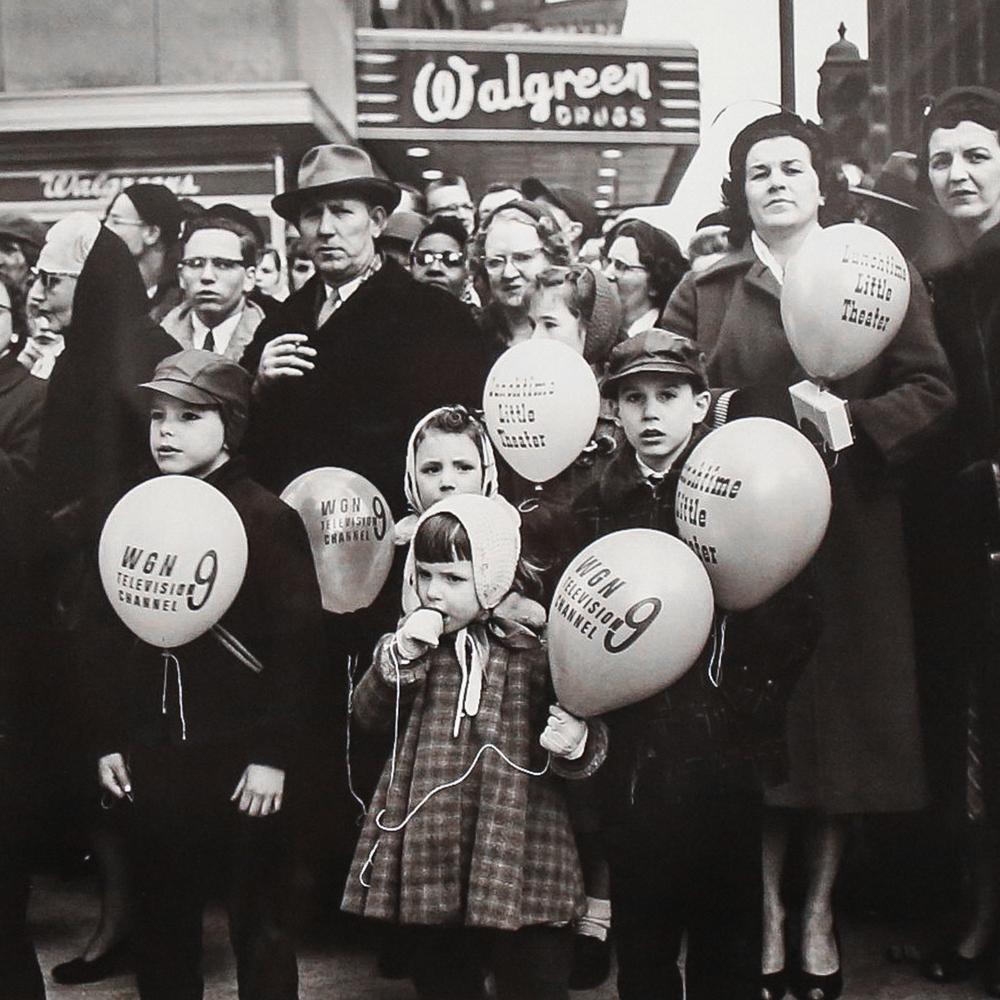 1950s Crowd with Balloons, Chicago (Modern gelatin silver print) by Vivian Maier.