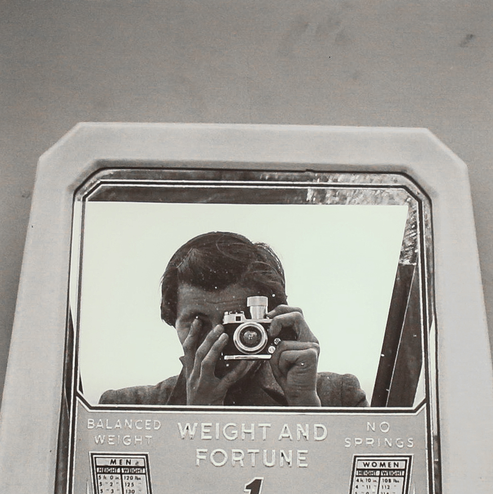 Self-Portrait, Weight & Fortune (Modern gelatin silver print) by Vivian Maier.