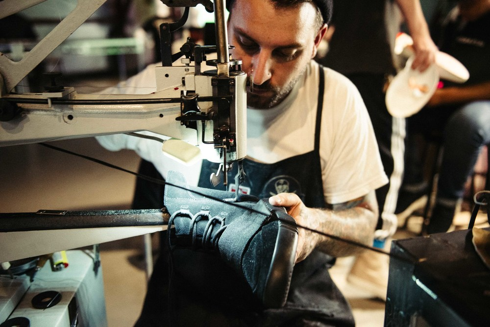 The Shoe Surgeon (Dominic Chambrone) customizing soccer cleats – and  black Yeezy 750's – at Adidas' Mercury Center. / Photo: © Diane Abapo for SUSPEND Magazine.