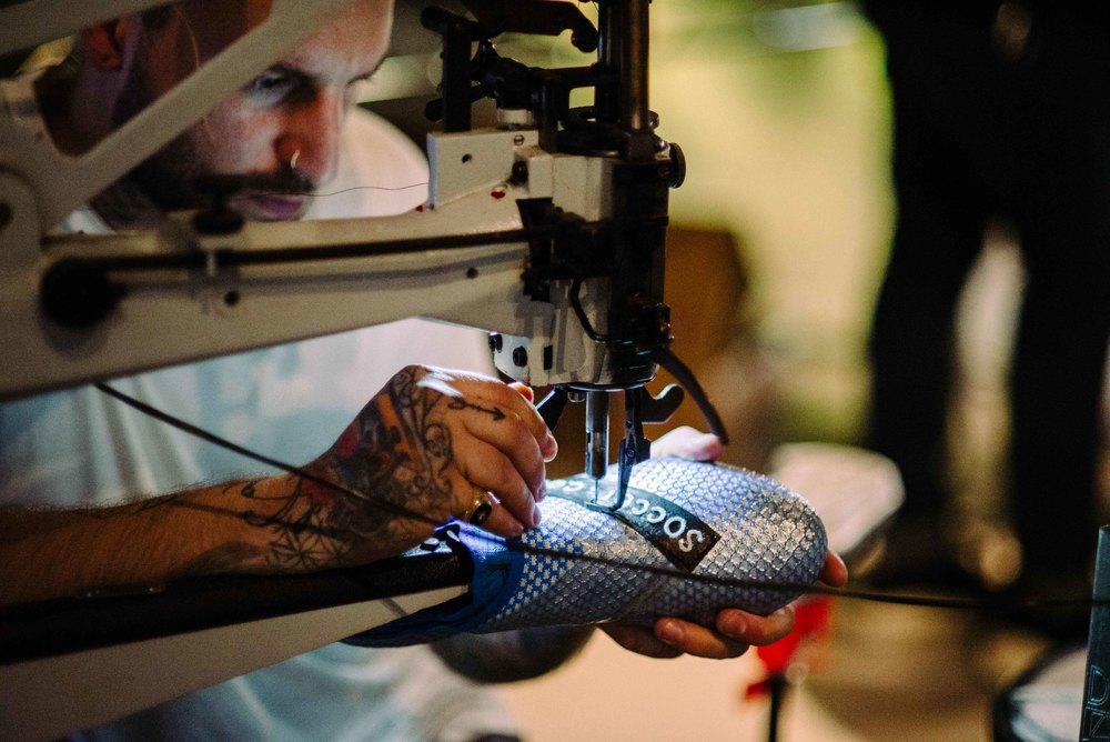 The Shoe Surgeon customizing soccer cleats at Adidas' Mercury Center. / Photo: © Diane Abapo for SUSPEND Magazine.