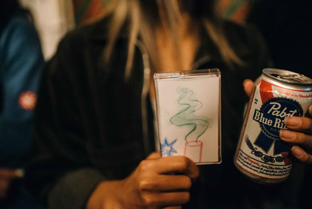 "Leslie with her ""Alive at Virgil Normal"" cassette with art by Matt McCormick at Virgil Normal. / Photo: © Diane Abapo for SUSPEND Magazine"