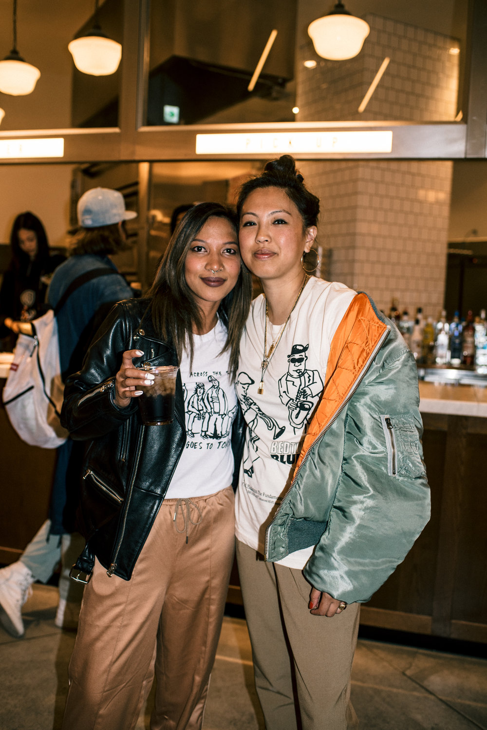 "Leslie Corpuz and Diane Abapo at ""Across the Street"" SUSPEND Magazine photo show (April 5) at Pizza Slice 2 in Tokyo. / Photo © SUSPENDMAG.COM"