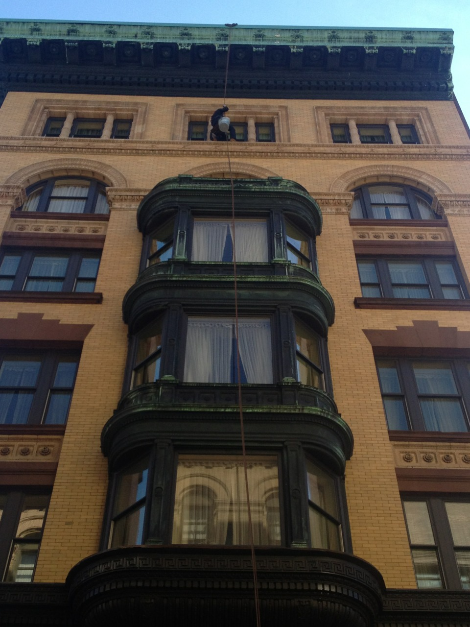 Window washing or urban acrobatics.