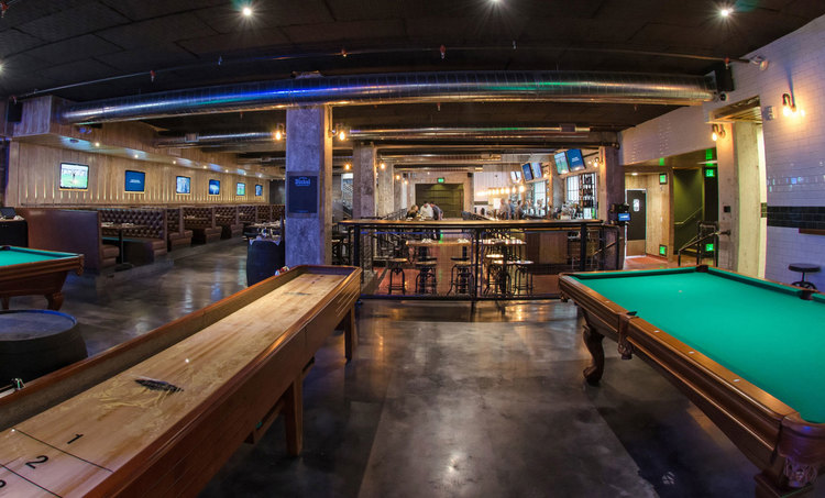 The G Pub comes equipped with a bar, plenty of tables, games, and karaoke rooms