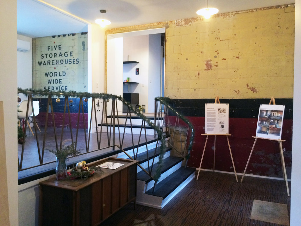 "This area, now exhibiting some of its historical signage, with new floors, finishes, fixtures, and treads now serves as the ""lobby"" and conference area into the Atlantic Designworks."