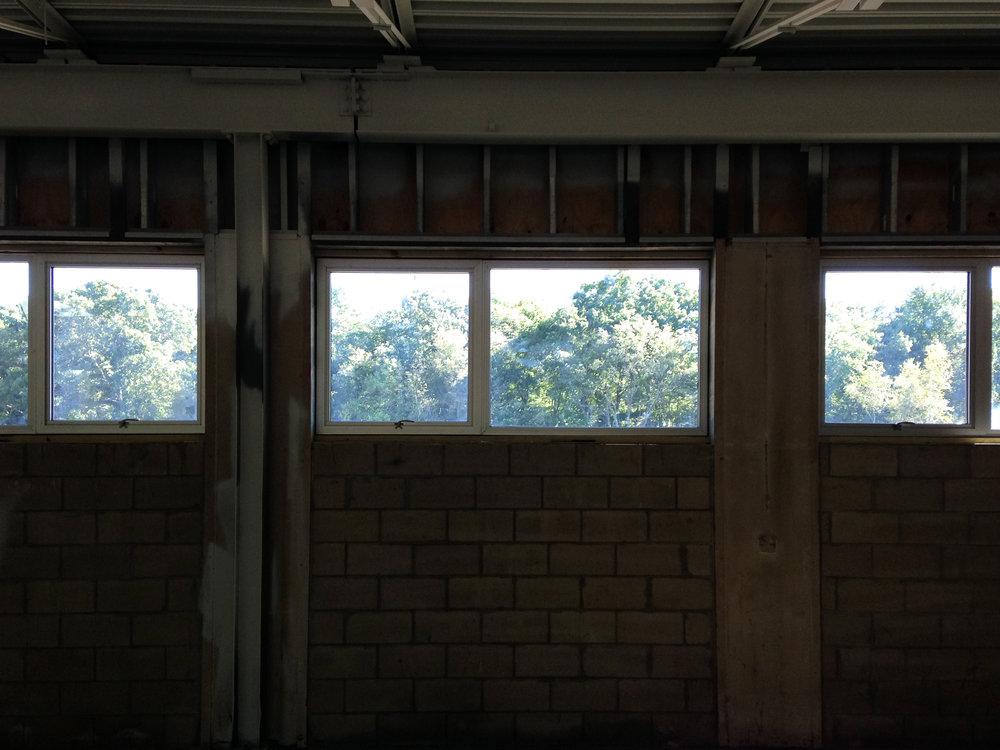 Windows installed, interiors awaiting their finishes