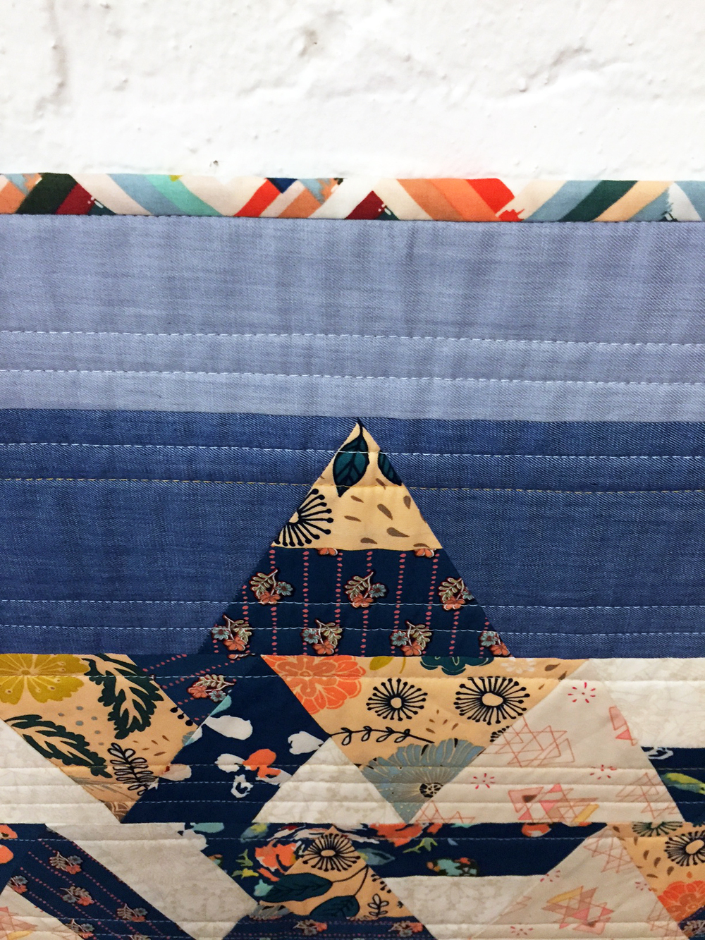 Fleet and flourish fabrics the tattooed quilter for Space mountain fabric