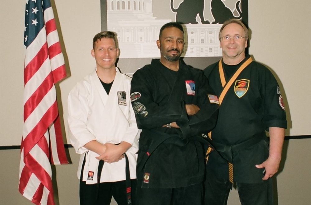 Promoting Urban Kempo's 1st official Black Belt--Ronald Aikens--in the Fall of 2014. Thank you Ron for following me through the park and towards Urban Kempo and all of my dreams! For sharing your kids with me in the dojo, for your help in creating our logo, for all of your donations hanging on the wall in my office and basically for being so amzingly cool. I look forward to your promotion in the Spring of 2016 to 2nd Dan!