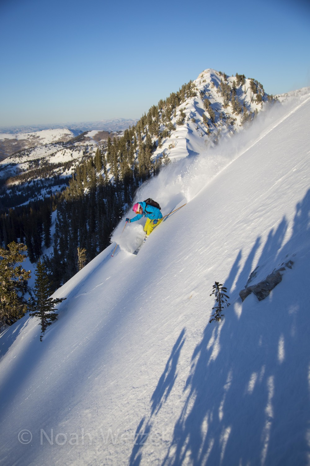 Lucy Sackbauer skiing at sunset in the Brighton Resort backcountry, Utah. Day 1