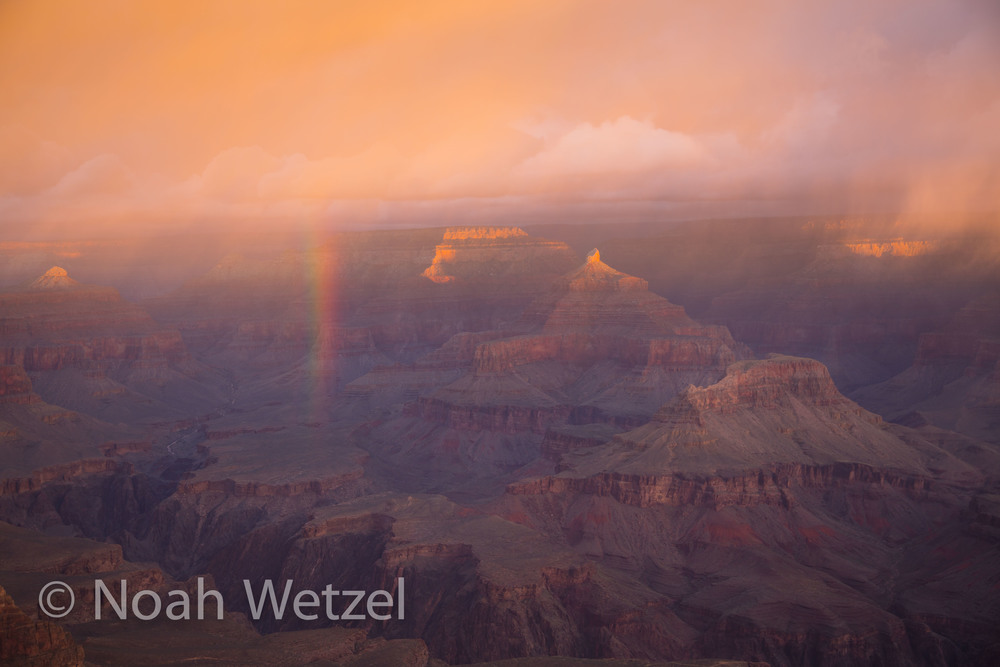 First light illuminating a rainbow in Grand Canyon National Park, Arizona.