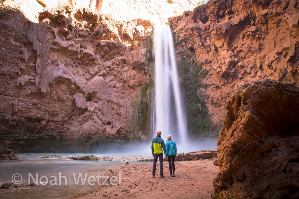 Jerome and Rachel soaking up Mooney Falls in Supai, Arizona