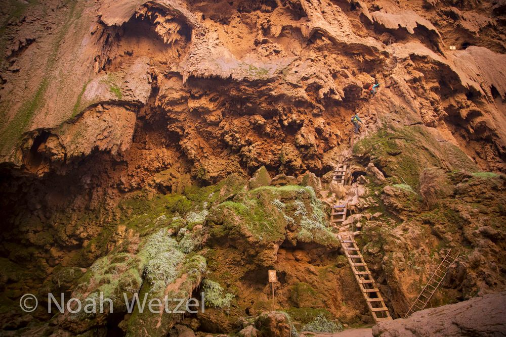 Rachel and Jerome ascend the Indiana Jones ladders at Mooney Falls. Supai, Arizona