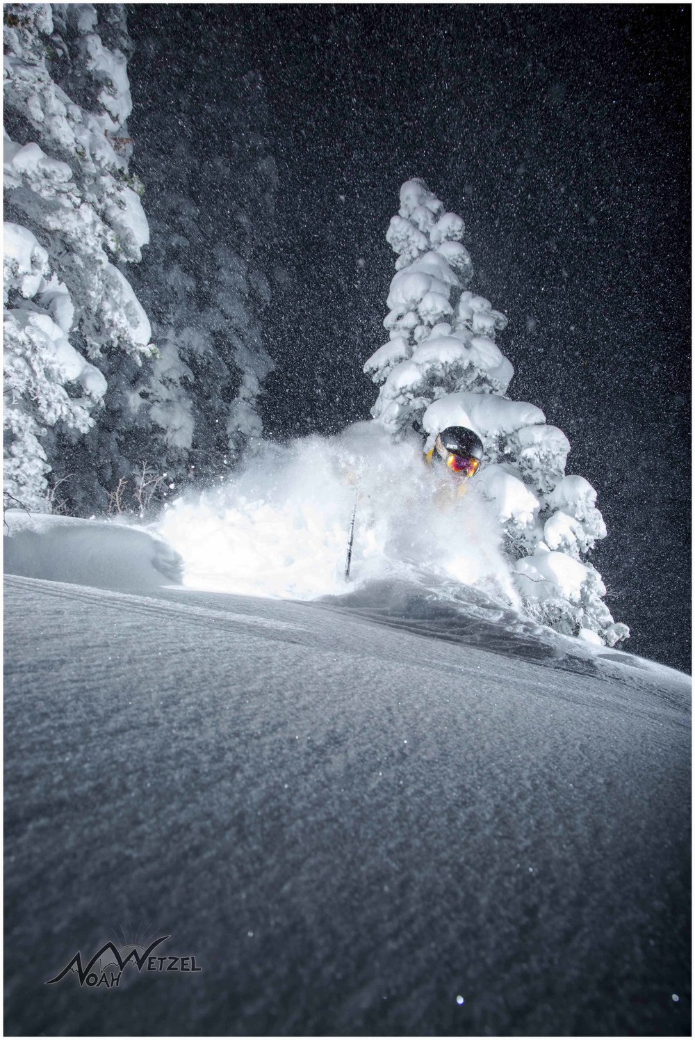 Chris Brule blows up a turn at night in Westward Ho at Alta Ski Area, Utah.