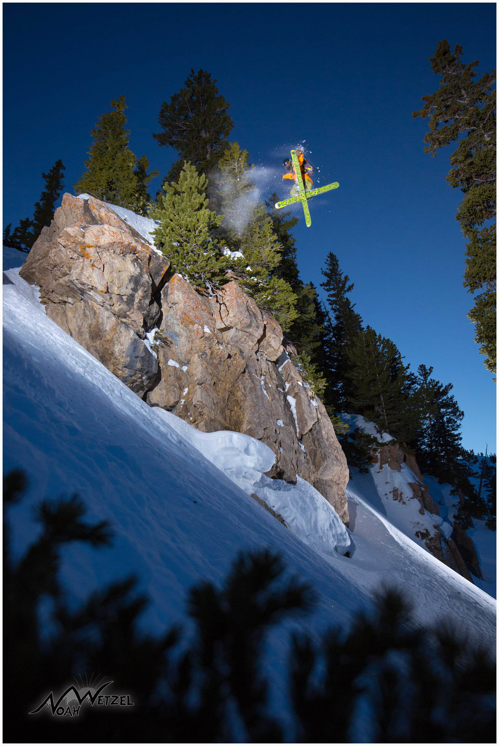 Willie Nelson floats a 360 with a leading tail grab in the Rocky Point backcountry at Alta Ski Area, Utah.