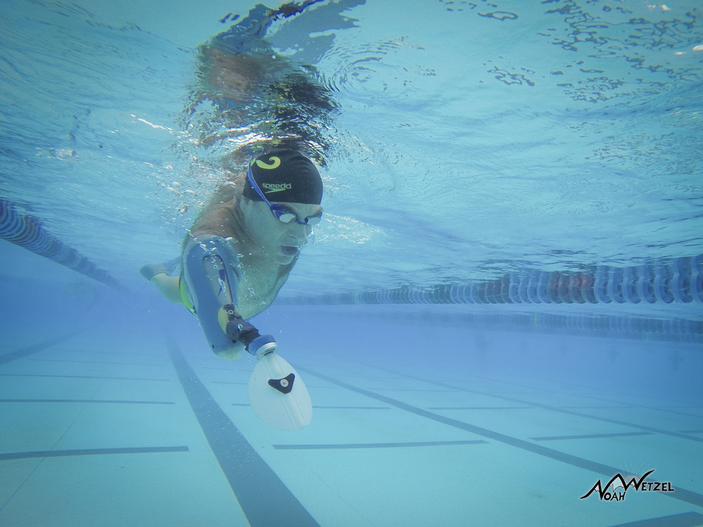 Peter Muller utilizing the specific swim arm. Simple GOPRO burst stills mode...swimming alongside him, multiple attempts.