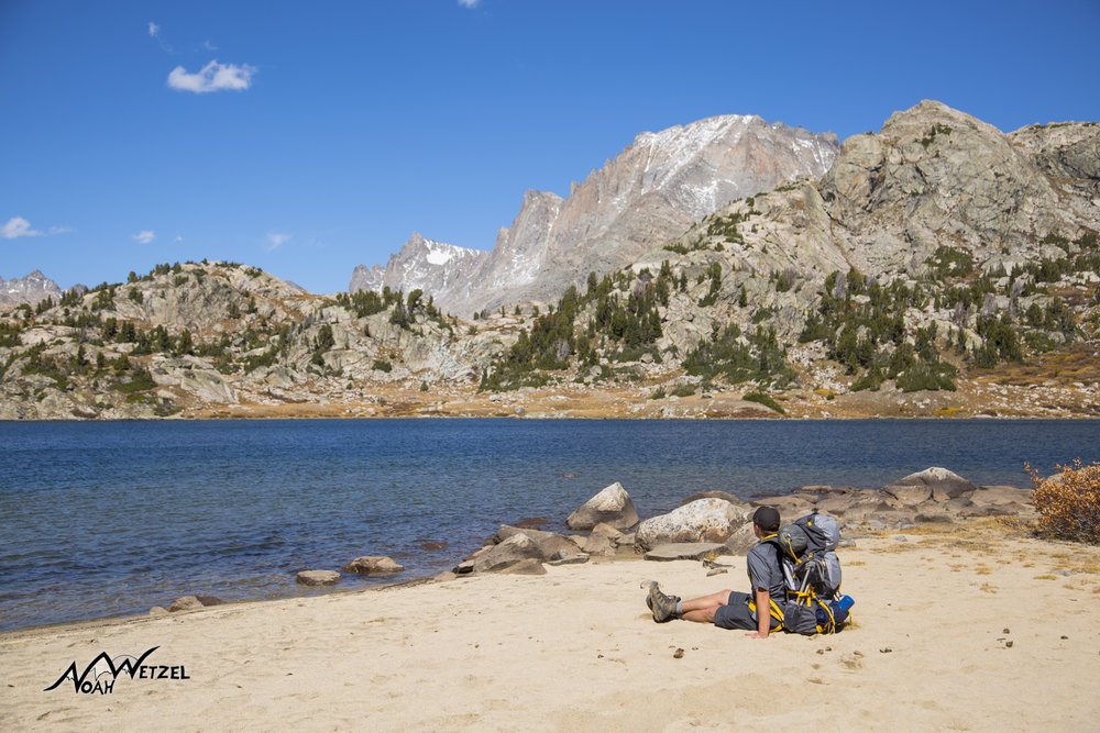 Ben Wetzel enjoying a high alpine beach on the banks of Island Lake in the Wind River Range. Wyoming