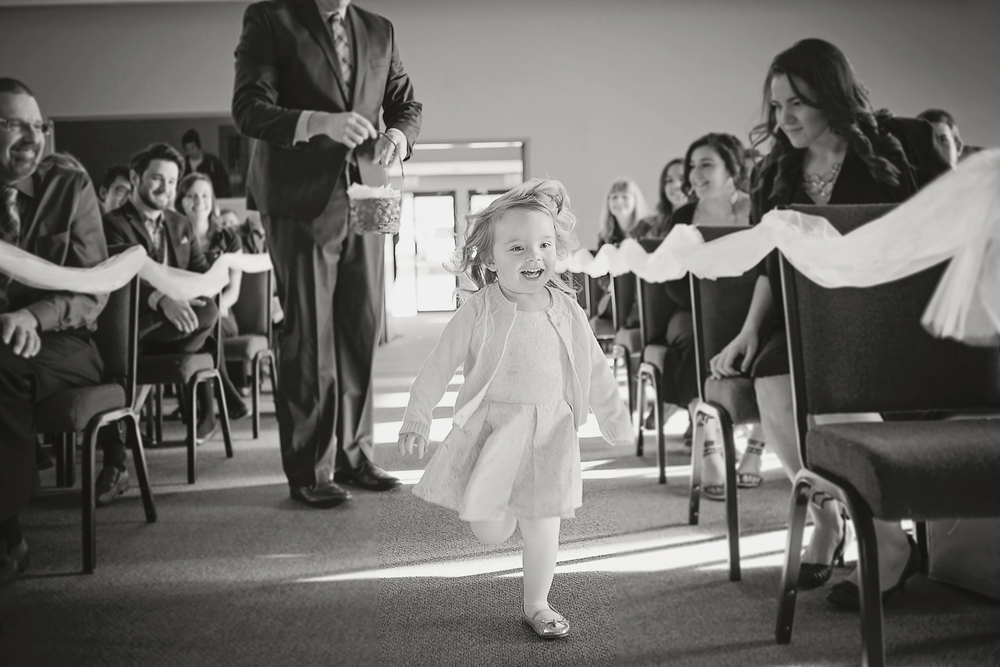 We had a runaway flower girl on our hands! But look how cute she is!