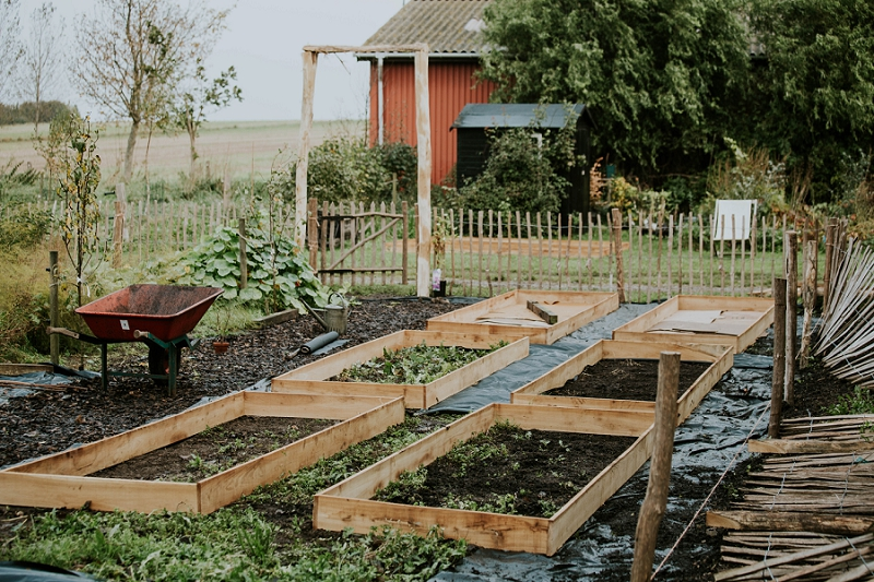 preparing-beds-for-organic-flower-farm-garden-design