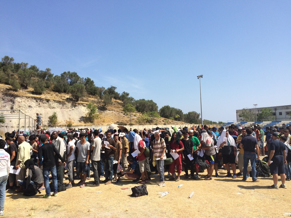Refugees and other migrants queue for registration, Lesbos island, Greece.  ©  Katy Lee