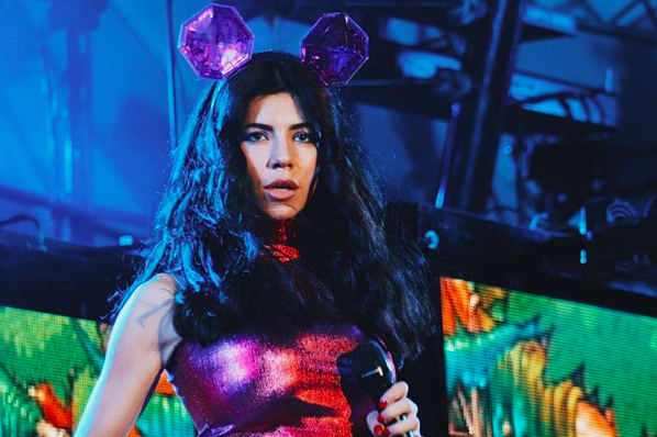 Marina's bespoke Pink Mega-Diamond Ears Headband at her Neon Nature Tour.