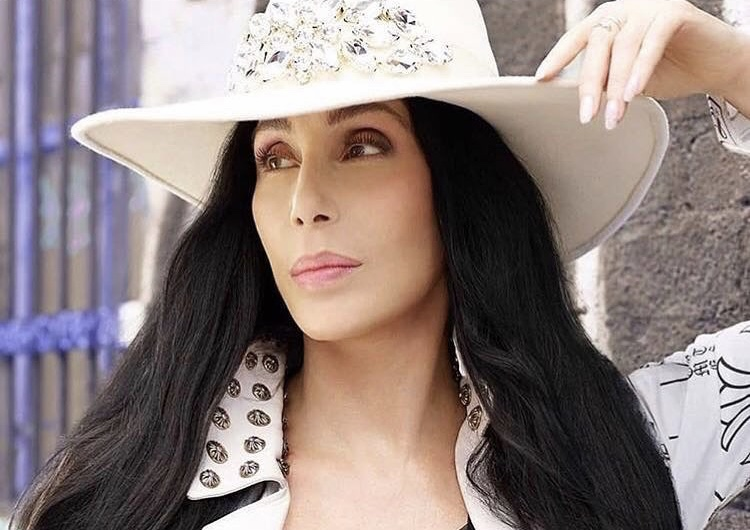 Cher in a custom crystal fedora.