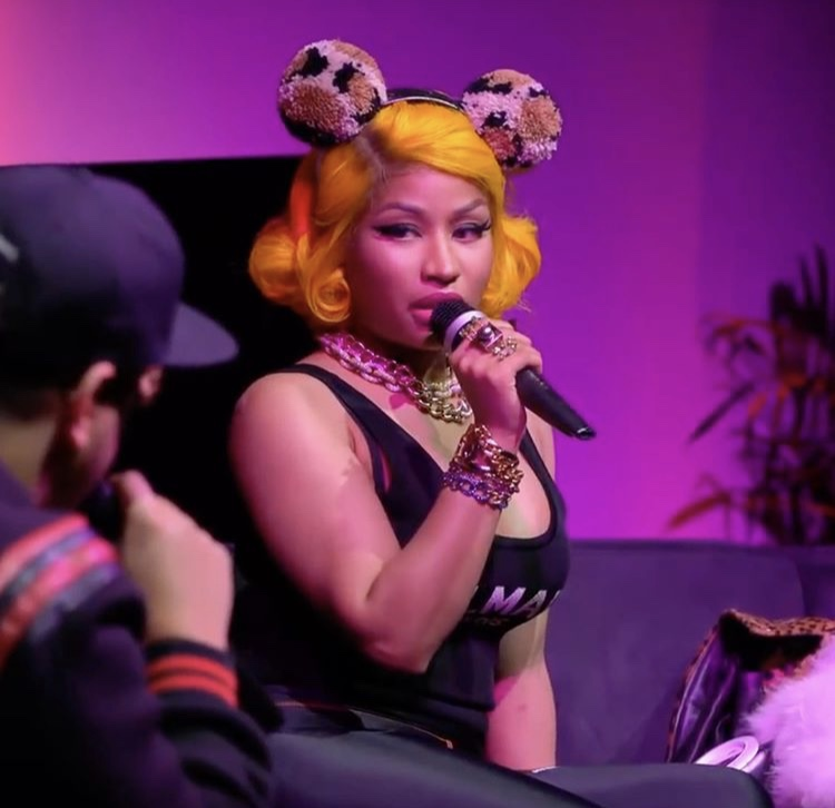 Nicki Minaj wearing leopard poms.