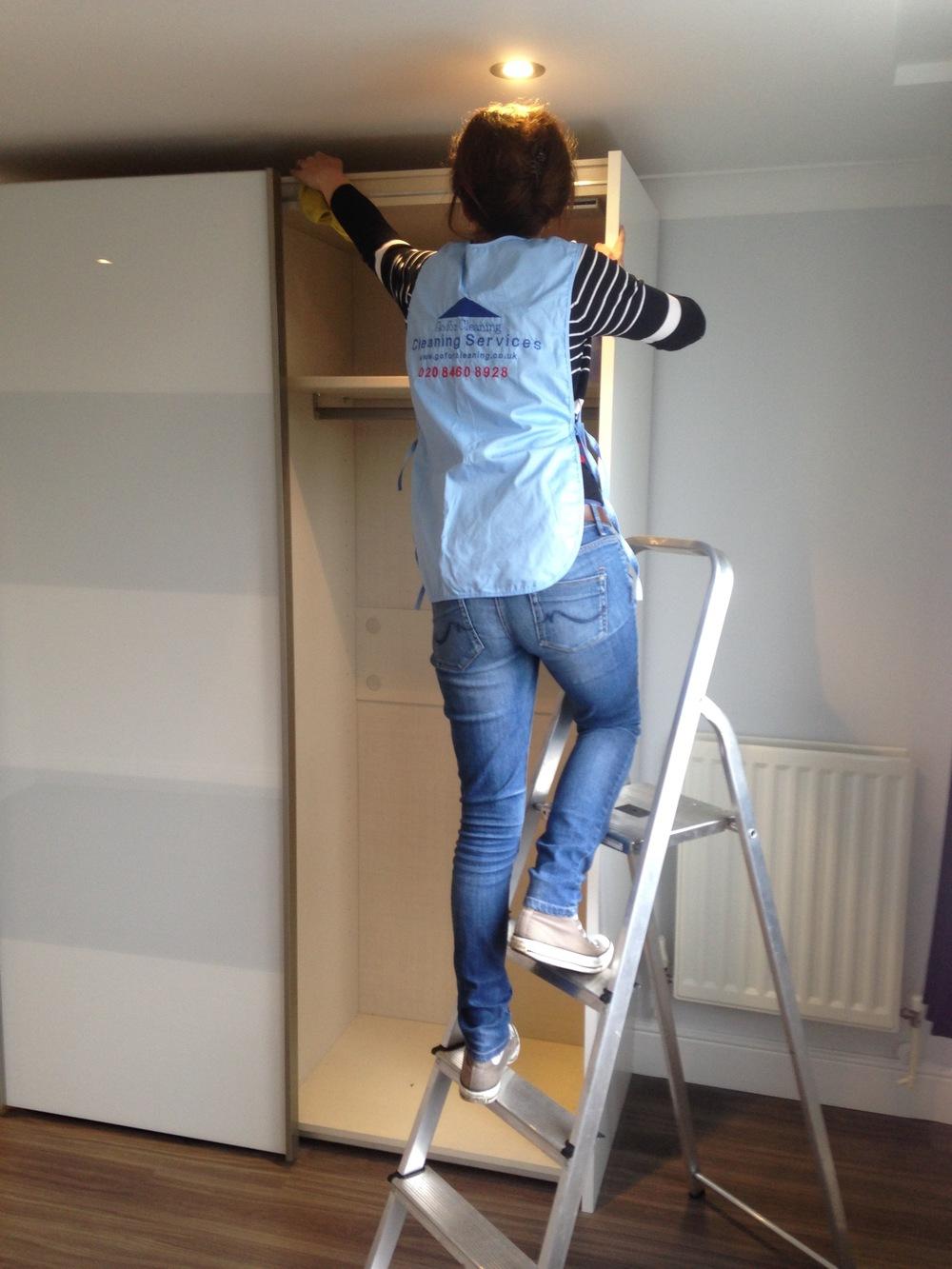 cleaning top of wardrobe.jpg