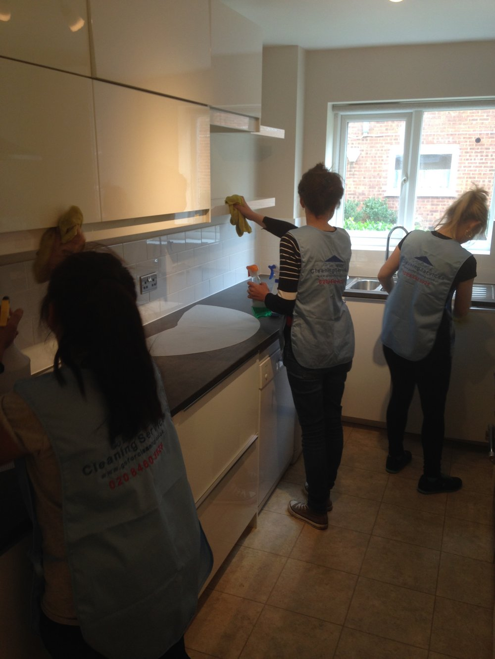 Team of cleaners in kitchen SW20.jpg