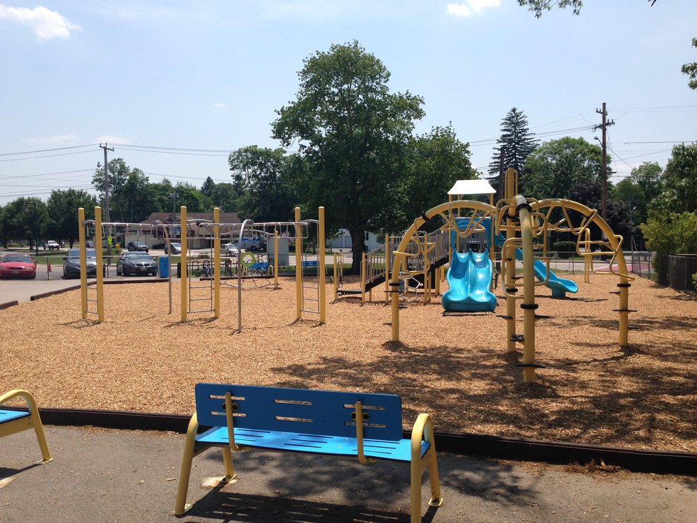 School Playground with matching play structures and benches.jpg