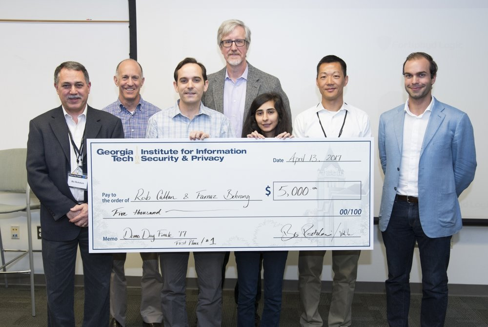 Rob Callan, Farnaz Behrang, and mentors celebrate the team's first-place win at IISP's Demo Day  ( source )
